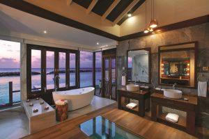 ATMOSPHERE KANIFUSHI MALDIVES WATER VILLA WITH POOL SUNSET VIEW FROM BATHROOM 1