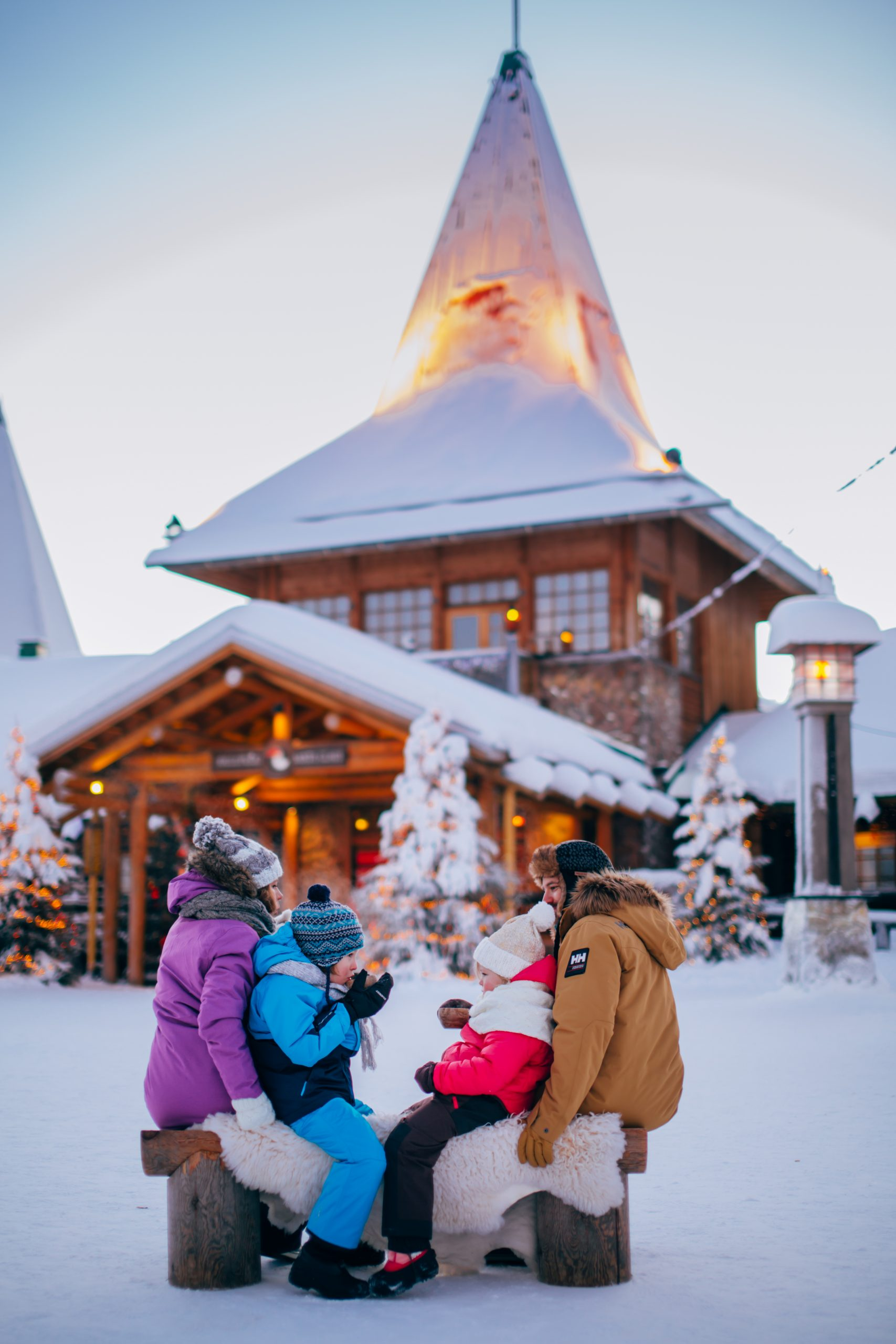 Family moment at Santa Claus Village in Rovaniemi Lapland Finland scaled