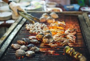 Bangkok Grilling seafood at street side restaurant in Chinatown